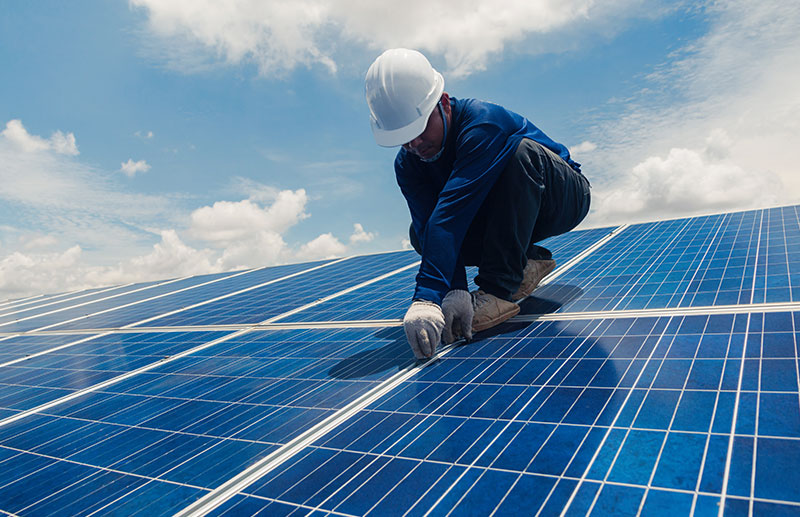 solar worker working on panels